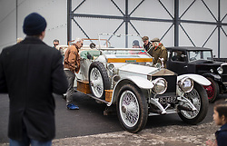 © Licensed to London News Pictures. 28/01/2018. Weybridge, UK. Visitors to Brooklands Museum admire a Rolls-Royce Silver Ghost from 1912 as members of The Vintage Sports-Car Club take part in New Year driving tests round the historic motor racing circuit. Photo credit: Peter Macdiarmid/LNP