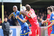 Tom Elliott forward for AFC Wimbledon (9) and Shaun Brisley defender for Leyton Orient (16) grapple during the Sky Bet League 2 match between AFC Wimbledon and Leyton Orient at the Cherry Red Records Stadium, Kingston, England on 23 April 2016. Photo by Stuart Butcher.