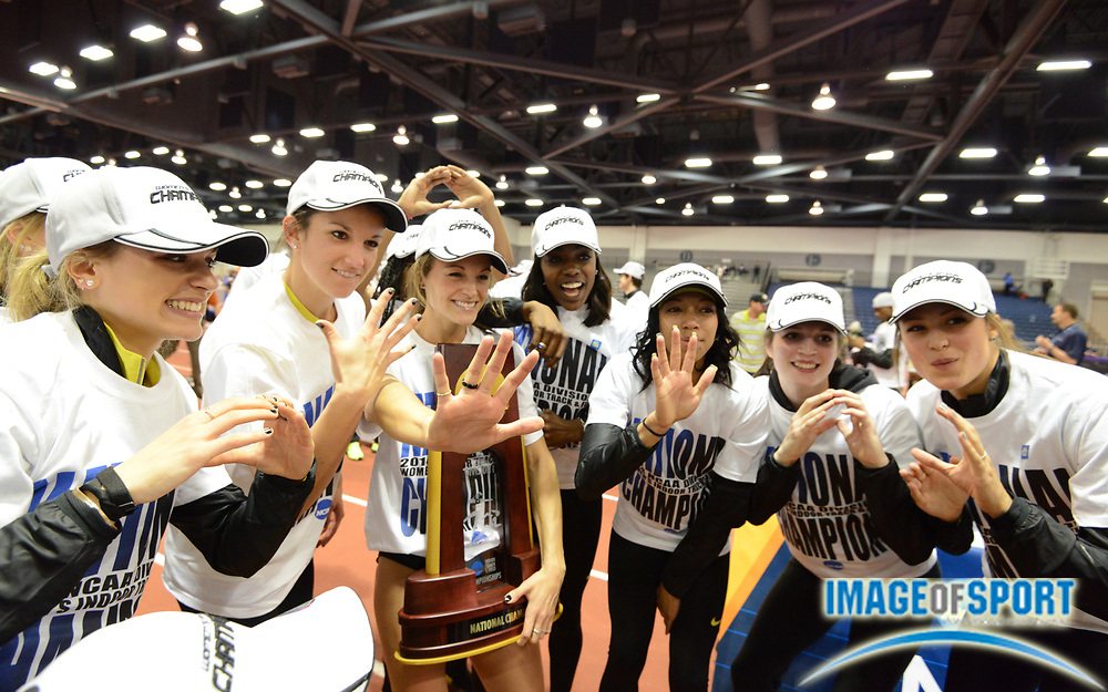 Mar 15, 2014; Albuquerque, NM, USA; Members of the Oregon womens team pose after winning the team title for the fifth year in a row in the 2014 NCAA Indoor Championships at Albuquerque Convention Center.