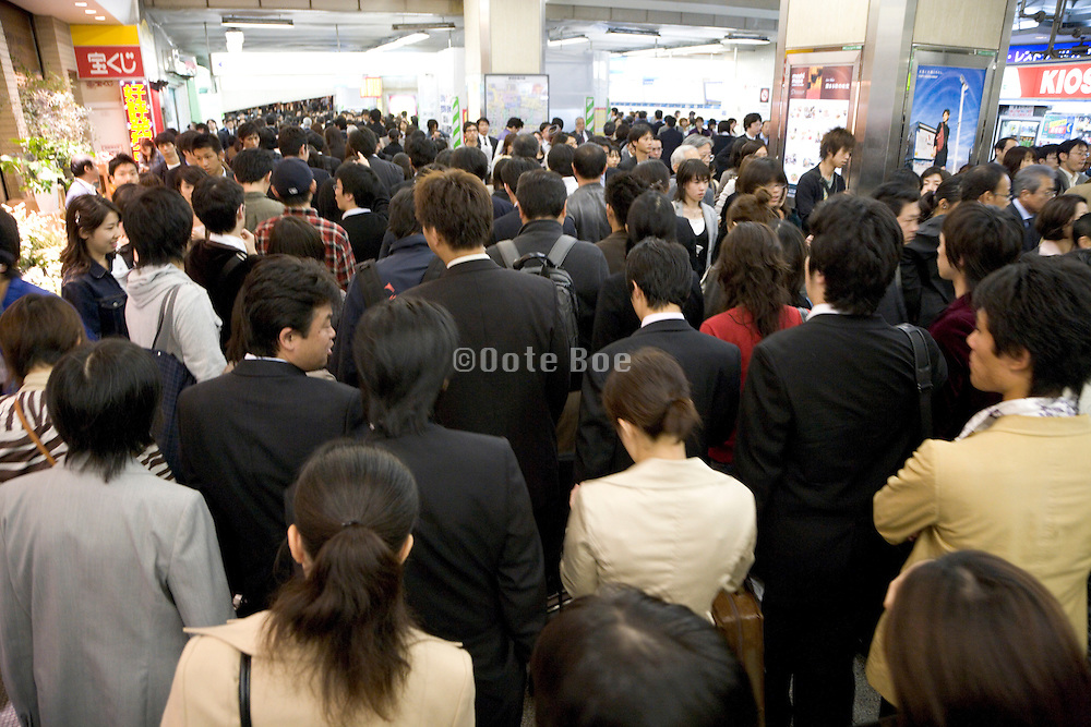 business commuters Shinjuku railway station Japan