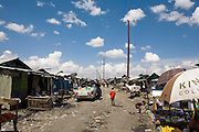 A view along one of the main streets in the Mukuru Kwa Mjenga slum, one of the largest in Nairobi it has a population of approx 420,000 people living there.