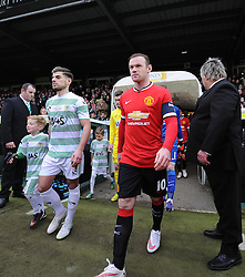 Yeovil Town's Joe Edwards and Manchester United's Wayne Rooney lead their teams out  - Photo mandatory by-line: Joe meredith/JMP - Mobile: 07966 386802 - 04/01/2015 - SPORT - football - Yeovil - Huish Park - Yeovil Town v Manchester United - FA Cup - Third Round