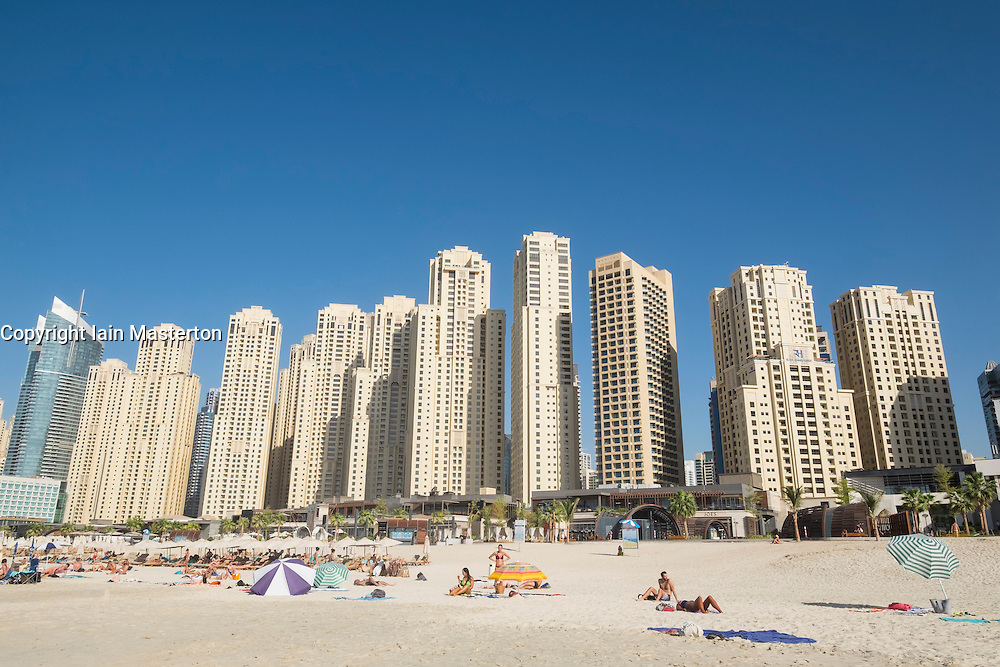 View of skyline of modern skyscrapers and beach at JBR area of Marina district of Dubai United Arab Emirates