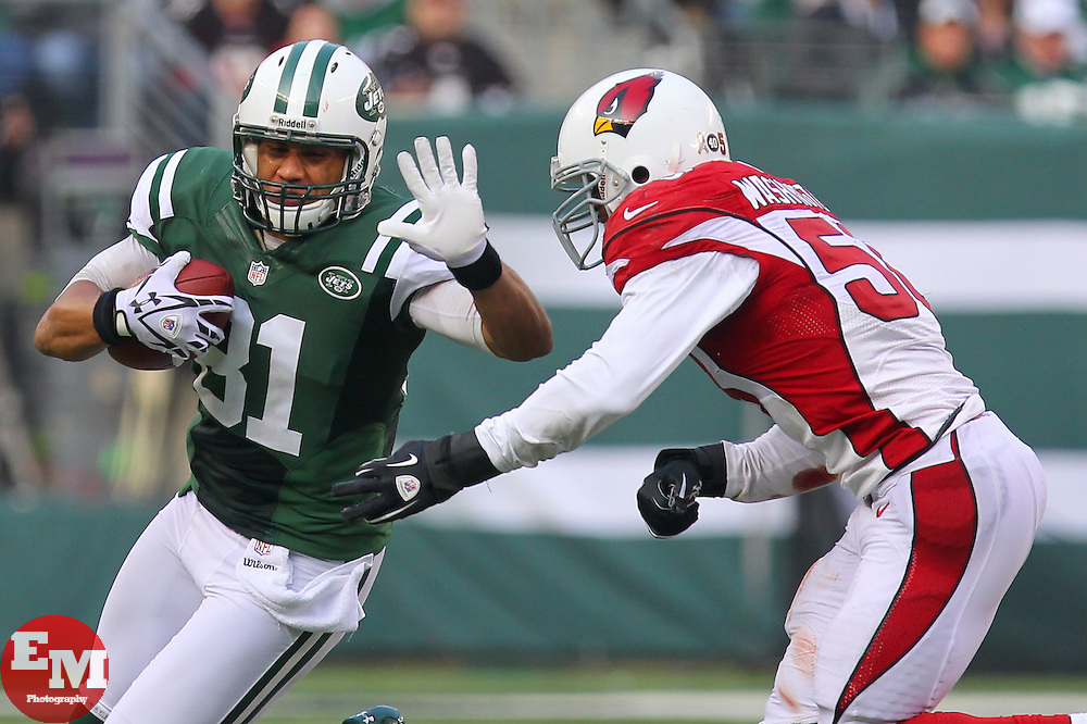 Dec 2, 2012; East Rutherford, NJ, USA; New York Jets tight end Dustin Keller (81) runs with the ball while being chased by Arizona Cardinals inside linebacker Daryl Washington (58) during the first half at MetLIfe Stadium.