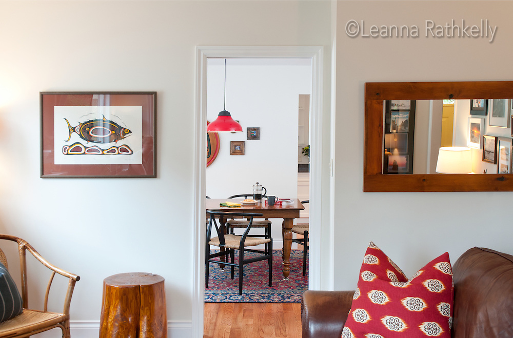 A dining room in a classic Oak bay home in Victoria is decorated with vintage finds and comfortable furniture.