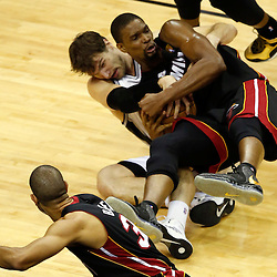 Jun 16, 2013; San Antonio, TX, USA; San Antonio Spurs center Tiago Splitter (22) goes after a loose ball against Miami Heat center Chris Bosh (1) during the second quarter of game five in the 2013 NBA Finals at the AT&T Center. Mandatory Credit: Derick E. Hingle-USA TODAY Sports