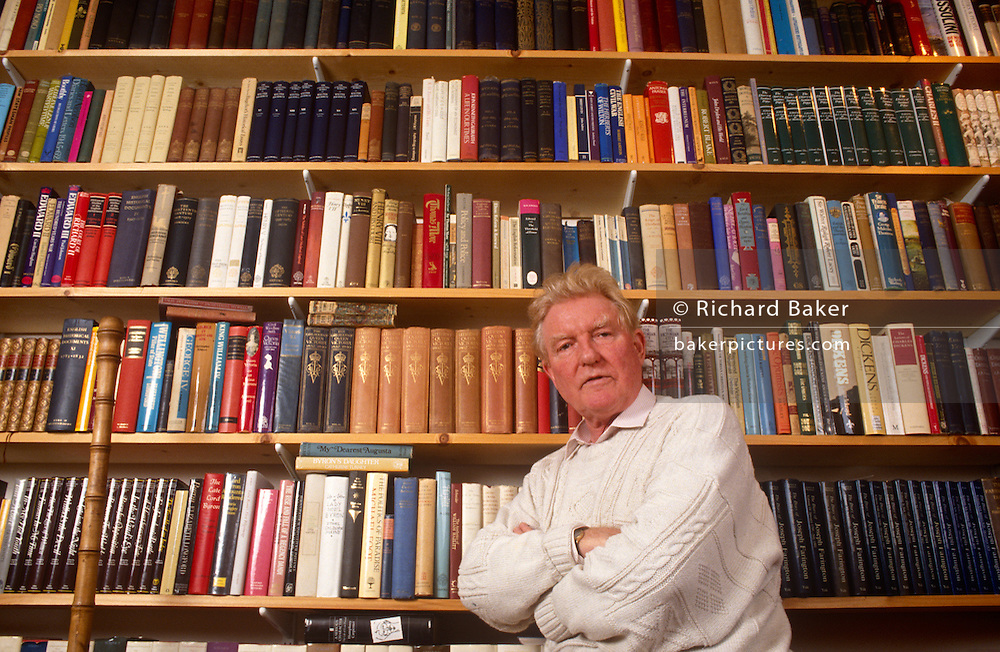 Surrounded by books is British Roman Catholic journalist, historian, speechwriter and author, Paul Johnson portrait at home. Paul Bede Johnson (born 2 November 1928) is an English journalist, historian, speechwriter and author. He was educated at the Jesuit independent school Stonyhurst College, and at Magdalen College, Oxford. Johnson first came to prominence in the 1950s as a journalist writing for, and later editing, the New Statesman magazine. A prolific writer, he has written over 40 books and contributed to numerous magazines and newspapers. While associated with the left in his early career, he is now a conservative popular historian. His sons are the journalist Daniel Johnson, founder of Standpoint, and the businessman Luke Johnson, former chairman of Channel 4..