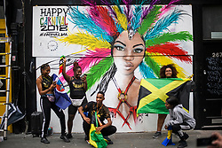 © Licensed to London News Pictures. 26/08/2018. London, UK. Carnival goers enjoy family day of the 2018 Notting Hill Carnival. Up to 1 million people are expected to attend this weekend's event that is one of the worlds largest street festivals. Photo credit: Ben Cawthra/LNP
