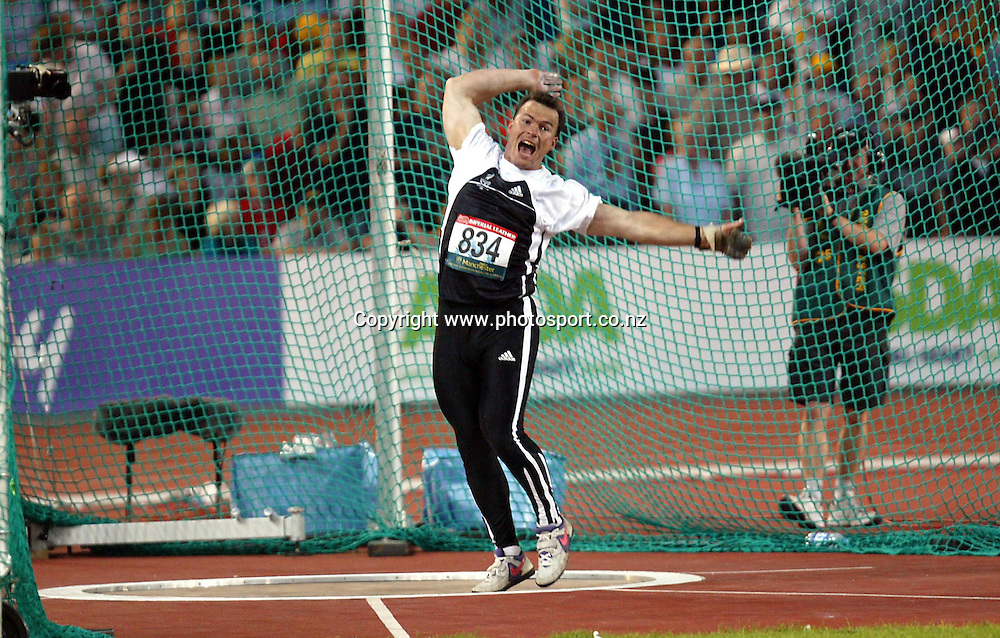 28 July 2002, City of Manchester Stadium,Sport city Commonwealth Games, Manchester, England<br />New Zealand  hammer thrower and silver medalist Phil Jensen in action tonight.<br />Pic: Andrew Cornaga/Photosport