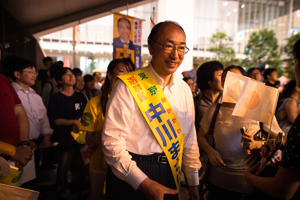 TOKYO, JAPAN - JULY 9 :  Masaharu Nakagawa a candidate of Liberal Democratic Party (LDP), greets spectator before campaign speech during the last day of Upper House election campaign outside of Akihabara Station in Tokyo, Japan on July 9, 2016. Tomorrow, July 10, 2016 will be the first Upper house election nation-wide in Japan that 18 years old can vote after government law changes its voting age from 20 years old to 18 years old. (Photo by Richard Atrero de Guzman/NURPhoto)
