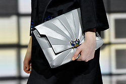 © Licensed to London News Pictures. 21/02/2016. Model on the catwalk  holding a clutch bag at the ANYA HINDMARCH Autumn/Winter 2016 show. Models, buyers, celebrities and the stylish descend upon London Fashion Week for the Autumn/Winters 2016 clothes collection shows. London, UK. Photo credit: Ray Tang/LNP