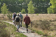 group of people walking through nature preserve Holland