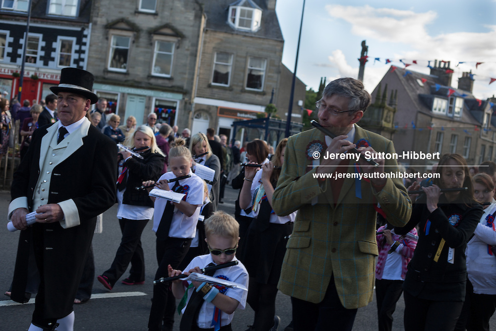The Thursday evening 'Cryin' o' The Burley' event, where townsfolk walk around the town and the common riding is proclaimed by a town crier. The Common Riding festivities in Selkirk, with Royal Burgh Standard Bearer Martin Rodgerson, in Selkirk, Scotland, Thursday 13th June 2013. <br /> N55&deg;32.829'<br /> W2&deg;50.494'