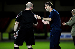Crystal Palace's Manger Dougie Freedman laughs with the referee - Photo mandatory by-line: Dougie Allward/Josephmeredith.com  - Tel: Mobile:07966 386802 08/08/2012 - SPORT - FOOTBALL - Pre Season - Friendly - Swindon  - County Ground - Swindon Town V Crystal Palace