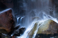 Rocks and boulders at the bottom of Narada Falls in Mount Rainier National Park, Washington State, USA
