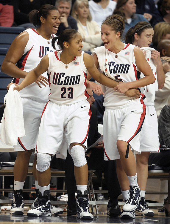 Connecticut players, from left,  Kaili McLaren, Maya Moore, Caroline Doty and Kelly Faris react after teammate Lorin Dixon, not shown, blocks a shot attempt by North Carolina in the second half of a women's NCAA college basketball game in Storrs, Conn., Saturday, Jan. 9, 2010.  (AP Photo/Jessica Hill)