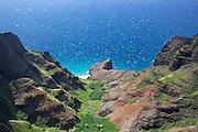 Aerial view of a green valley on the Na Pali coastline, on the island of Kauai, Hawaii.