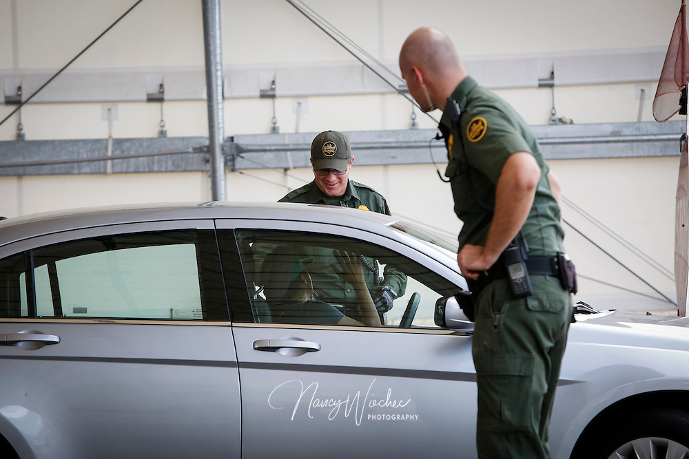A driver talks with an agent at the I-19 U.S. Border Patrol checkpoint near Tubac, Ariz., July 14. The checkpoint is located about 25 miles north of the U.S.-Mexico border. NANCY WIECHEC