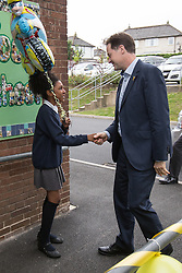 © Licensed to London News Pictures . 03/07/2014 . Leeds , UK . The Deputy Prime Minister , NICK CLEGG MP , at Ireland Wood Primary School in Leeds today (Thursday 3rd July 2014) greeted by pupil Lashay Henry-Welsh (11) from Yeadon in Leeds (left) . The Liberal Democrat leader and MP for Sheffield Hallam watches a Grand Depart school event with children taking part in cycling time trials and singing the the Tour de France anthem . Photo credit : Joel Goodman/LNP