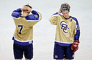 8 MARCH 2011 -- ST. LOUIS -- Christian Brothers College High School hockey players Joshua Gray (7) and Tanner Bulejski (10) ponder the Cadets 7-3 loss to Francis Howell Central High School following the Mid States Club Hockey Association Challenge Cup finals at the Scottrade Center in St. Louis Tuesday, March 8, 2011. Howell Central beat CBC 7-3 to take the Challenge Cup. Both Gray and Bulejeski are seniors. Image © copyright 2011 Sid Hastings.