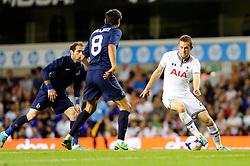 Tottenham Hotspur's Gylfi Sigurosson controls the ball closely surrounded by defenders - Photo mandatory by-line: Dougie Allward/JMP - Tel: Mobile: 07966 386802 27/08/2013 - SPORT - FOOTBALL - White Hart Lane - London - Tottenham Hotspur V Dinamo Tbilisi -  UEFA EUROPA LEAGUE - PLAY-OFF - SECOND LEG