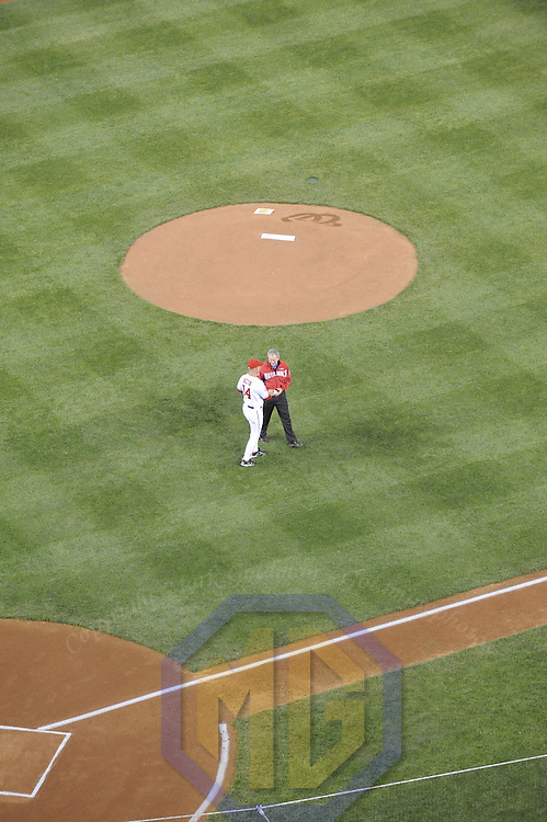 30 March 2008:  President of the United States, George H.W. Bush greets  Washington Nationals manager Manny Acta (L) after throwing out the ceremonial first pitch to start the opening game between the Atlanta Braves and the Washington Nationals.  The Nationals defeated the Braves 3-2 on opening day at the new Nationals Park in Washington, D.C.   ****For Editorial Use Only****