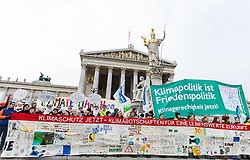 "29.11.2015, Innere Stadt, Wien, AUT, Globaler Marsch ""System Change, not Climate Change!"" anlässlich des ab morgen stattfindenden Klimagipfel ""COP21"" in Paris. im Bild Demonstranten vor dem Parlament // demonstrators in front of the austrian parliament during global climate march in austria according climate summit in paris in the inner city in Vienna, Austria on 2015/11/29 EXPA Pictures © 2015, PhotoCredit: EXPA/ Michael Gruber"