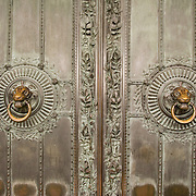Lion head door pulls on entry door of Sacre-Coeur church, Montmartre, Paris, France<br />