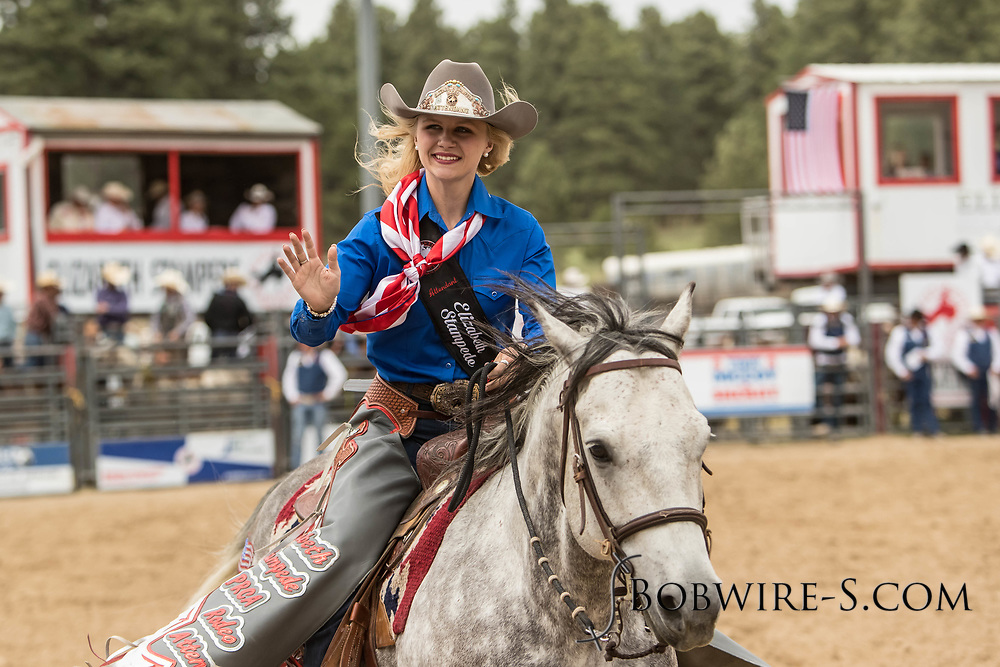 Attendant Brittany Vogl takes a lap of the arena during the third performance of the Elizabeth Stampede on Sunday, June 3, 2018.