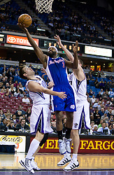 February 28, 2010; Sacramento, CA, USA;  Los Angeles Clippers guard Baron Davis (1) shoot over Sacramento Kings guard Beno Udrih (19) during the first quarter at the ARCO Arena. Sacramento defeated Los Angeles 97-92.