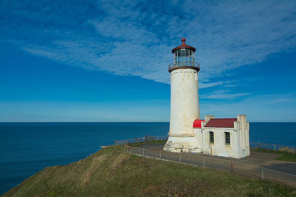 This first lighthouse in the Pacific Northwest at the mouth of the Columbia River was recommended to be built in 1848, and be located at Cape Disappointment, Washington in what was then the Oregon Territory. It was finally constructed, then officially lit on October 15, 1856 where it served for over 150 years. In 2008, the automated red and white flashing light was finally deactivated. An observation deck has been built since then for the US Coast Guard to monitor traffic and bar conditions.