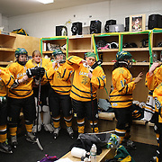 Hamden High School girls ice hockey team in the dressing room as they prepare for a match against Simsbury at Hamden High School Ice Rink,  Hamden, Connecticut, USA. 20th February 2014. Photo Tim Clayton
