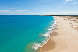 The long stretch of sand of Broome's Cable Beach, north of the rocks.