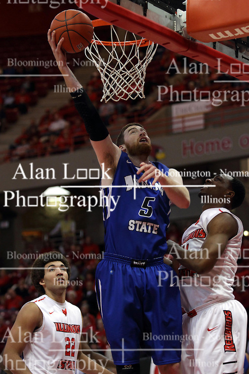 31 December 2014:  Justin Gant slips under the bucket for a hook shot passing Reggie Lynch and MiKyle McIntosh during an NCAA Division 1 Missouri Valley Conference (MVC) men's basketball game between the Indiana State Sycamores beat the Illinois State Redbirds 63-61 at Redbird Arena in Normal Illinois