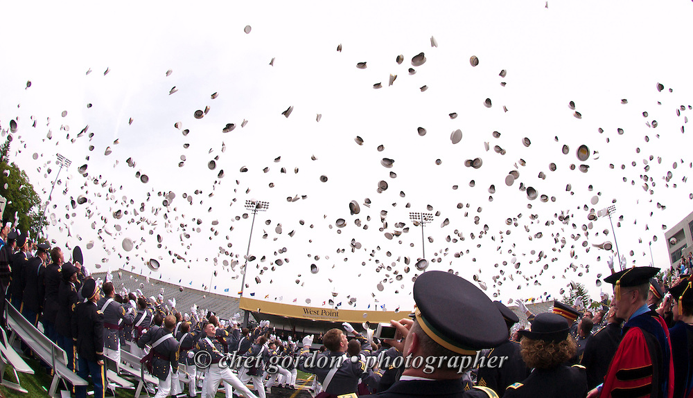 """Graduating cadets toss their covers skyward in the traditional """"hat toss"""" during the United States Military Academy's 2010 Graduation and Commissioning Ceremony at Michie Stadium in West Point, NY on Saturday, May 22, 2010. President Barack Obama delivered the commencement address as 1,002 cadets received their diplomas and were commissioned as 2nd. Lieutenants in the U.S. Army.  Times Herald-Record/CHET GORDON"""
