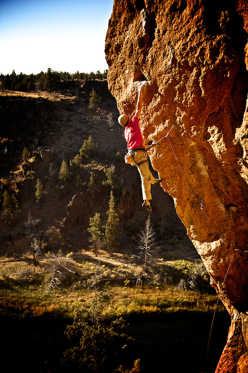 John Chipouras hangs on after completing a tough move at Smith Rock.