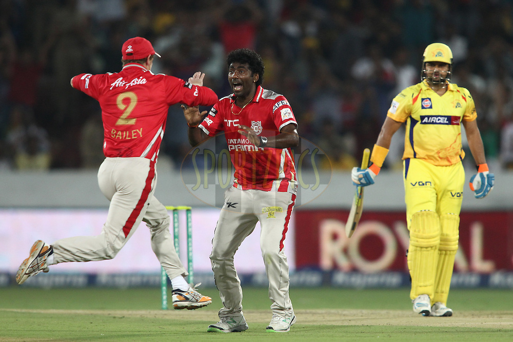 Kings XI Punjab captain George Bailey and Parvinder Awana of the Kings XI Punjab celebrate getting Suresh Raina of the Chennai Super Kings wicket during the second semi final match of the Oppo Champions League Twenty20 between the Kings XI Punjab and the Chennai Superkings held at the Rajiv Gandhi Cricket Stadium, Hyderabad, India on the 2nd October 2014<br /> <br /> Photo by:  Shaun Roy / Sportzpics/ CLT20<br /> <br /> <br /> Image use is subject to the terms and conditions as laid out by the BCCI/ CLT20.  The terms and conditions can be downloaded here:<br /> <br /> http://sportzpics.photoshelter.com/gallery/CLT20-Image-Terms-and-Conditions-2014/G0000IfNJn535VPU/C0000QhhKadWcjYs