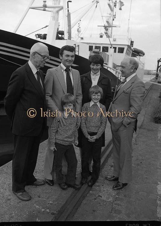 """Super Trawler """"Antarctic"""".    (N44)..1980..02.10.1980..10.02.1980..2nd October 1980..The first of five super-trawlers for Ireland, The Antarctic, for Kevin McHugh,an Achaill Islander,arrived in Dublin today.The vessel whch cost over £2million marks the beginning of a middle water fleet for Ireland..Picture shows Mr Michael McHugh,Chairman Irish Fish Producers Organisation, his son Kevin McHugh, Skipper of Antarctic, Vera McHugh, two of their children,Karl (7),Paul (9) and mr Brendan O'Kelly, Chairman ,Bórd Iascaigh Mhara."""