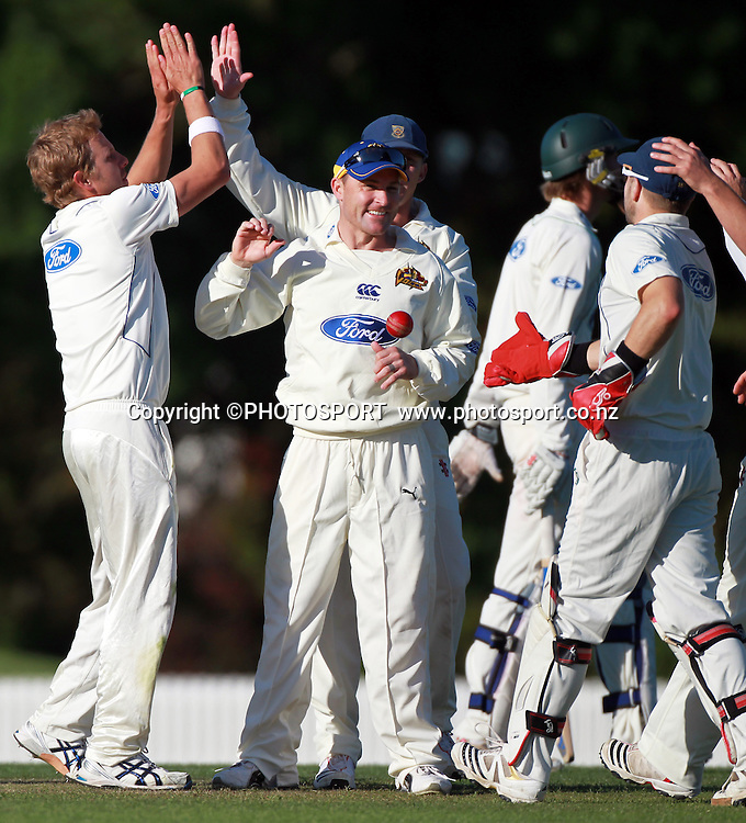 Otago players celebrate with bowler Neil Wagner after a wicket late in the day, Brendon McCullum throws the ball. Otago Volts v Central Districts Stags, 4 Day Plunket Shield cricket match, Bert Sutcliffe Oval, Lincoln, Monday 14 November 2011. Photo : Joseph Johnson / photosport.co.nz