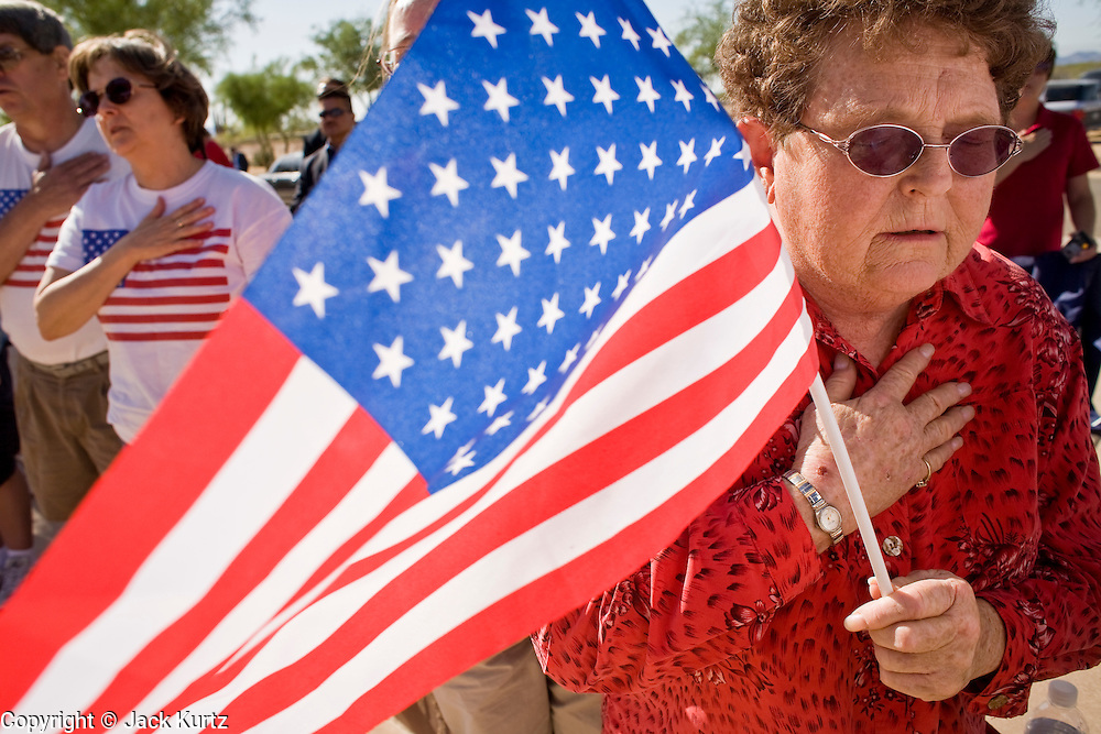 28 MAY 2007 -- PHOENIX, AZ: MARGIE HOFFER, from Phoenix, says the Pledge of Allegiance during the Memorial Day ceremony at the National Memorial Cemetery in Phoenix, AZ, Monday. There are more than 46,000 people buried in the National Memorial Cemetery in Phoenix.  Photo by Jack Kurtz/ZUMA Press
