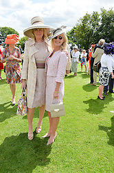 Left to right, LOUISE FENNELL and ANGIE RUTHERFORD at the Qatar Goodwood Festival - Ladies Day held at Goodwood Racecourse, West Sussex on 30th July 2015.