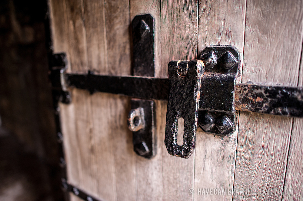 A solid oak door with a metal lock at Caernarfon Castle in northwest Wales. A castle originally stood on the site dating back to the late 11th century, but in the late 13th century King Edward I commissioned a new structure that stands to this day. It has distinctive towers and is one of the best preserved of the series of castles Edward I commissioned.