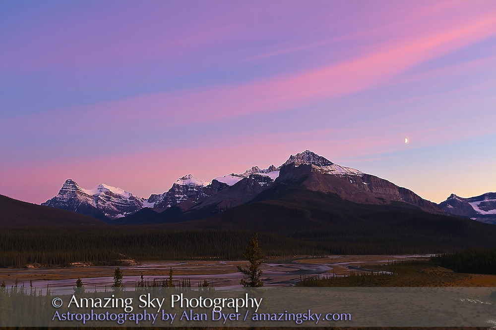Twilight at Saskatchewan River Crossing, Banff, Alberta, Sept 3, 2011, with the waxing crescent Moon in the southwest sky. Taken from the overlook near the Sask River Resort off the Icefields Parkway. Looking toward the Saskatchewan and Howse Rivers, with Mt. Cephren the prominent peak at left. This is a 6-image High Dynamic Range stack of exposures taken at 2/3rd f-stop intervals, using the Canon 7D at ISO 100 and 10-22mm lens at 22mm and f/5.6.