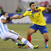 Jefferson Montero, (right), Ecuador, is challenged by Javier Mascherano, Argentina, during the Argentina Vs Ecuador International friendly football match at MetLife Stadium, New Jersey. USA. 15th November 2013. Photo Tim Clayton