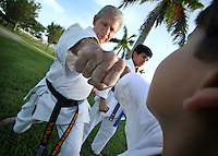 Karate coach Vicente Gonzalez, left, during his training session at Sunset Lake Community Center on Monday July 6, 2009. Staff photo/Cristobal Herrera..
