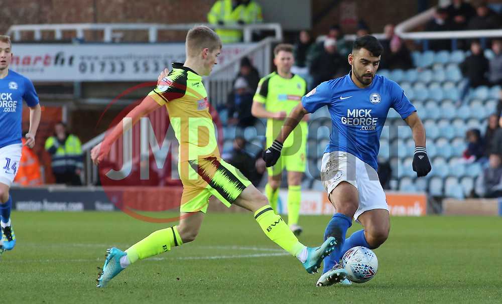 Serhat Tasdemir of Peterborough United in action with Ronan Darcy of Bolton Wanderers - Mandatory by-line: Joe Dent/JMP - 14/12/2019 - FOOTBALL - Weston Homes Stadium - Peterborough, England - Peterborough United v Bolton Wanderers - Sky Bet League One
