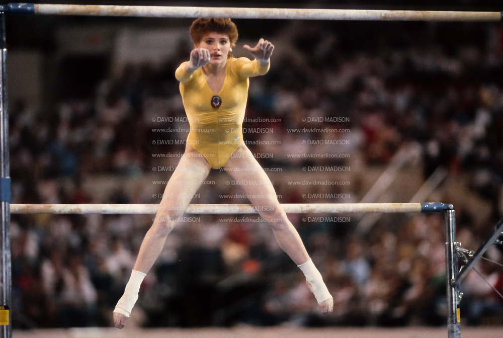 PHOENIX - APRIL 24:  Elena Shevchenko of the USSR competes on the uneven bars during a USA - USSR gymnastics meet on April 24, 1988  at the Arizona Veterans Memorial Coliseum in Phoenix, Arizona.  (Photo by David Madison/Getty Images)