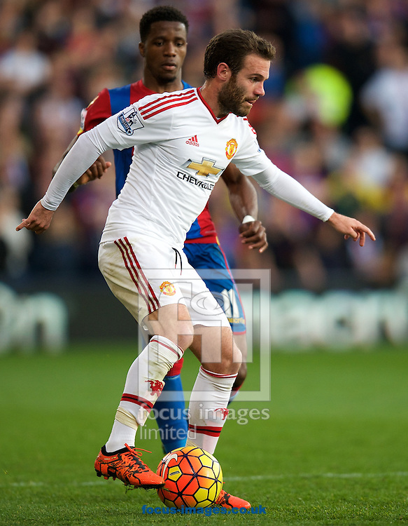 Juan Mata of Manchester United and Wilfried Zaha of Crystal Palace during the Barclays Premier League match at Selhurst Park, London<br /> Picture by Alan Stanford/Focus Images Ltd +44 7915 056117<br /> 31/10/2015