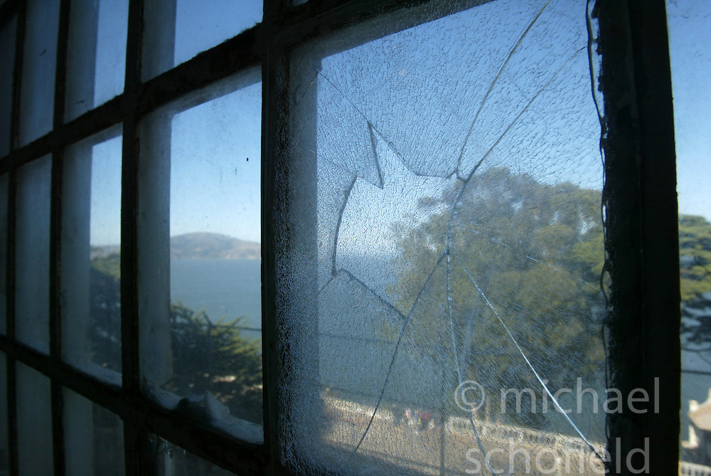 A broken window at the former prison on Alcatraz Island, San Francisco Bay, California, USA , taken in September 2004..©Pic : Michael Schofield.