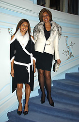 Left to right, MISS DIVIA LALVANI and her mother MRS VIMLA LALVANI  at jewellers Tiffany's Christmas party held at The Savile Club, 69 Brook Street, London on 14th December 2004.<br />